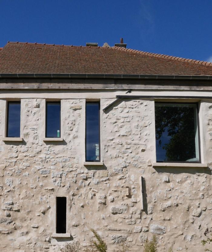Transformation d'une grange en loft : Détail façade sur jardin